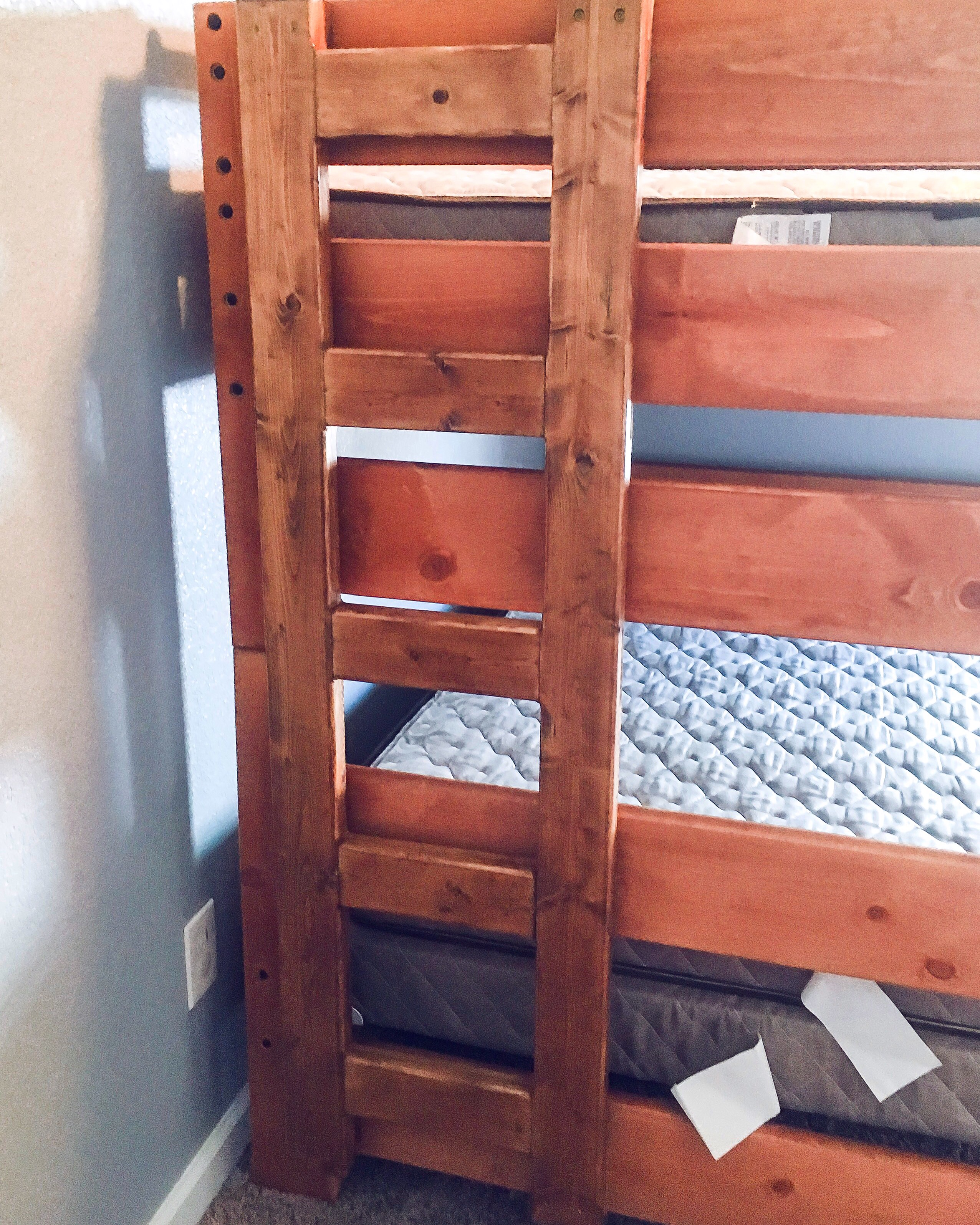 We built this ladder for the bed